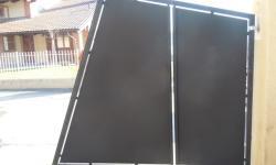 Cancello in stile moderno tamponato in lamiera, particolare anta