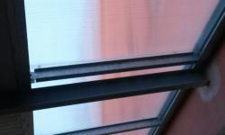 Pensilina in ferro, particolare lucernario in policarbonato